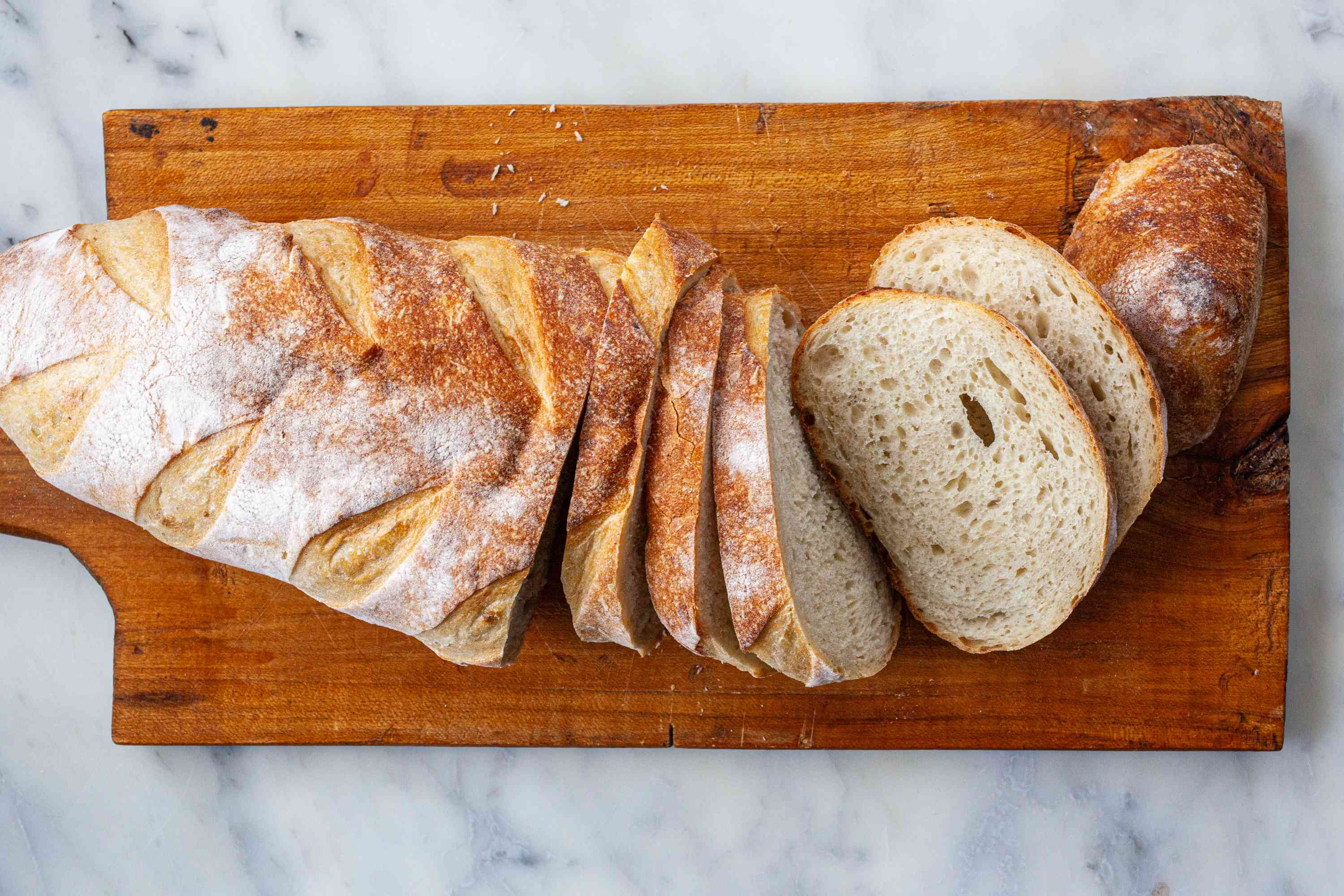 Sliced bread on a cutting board to make Spanish Style Migas.