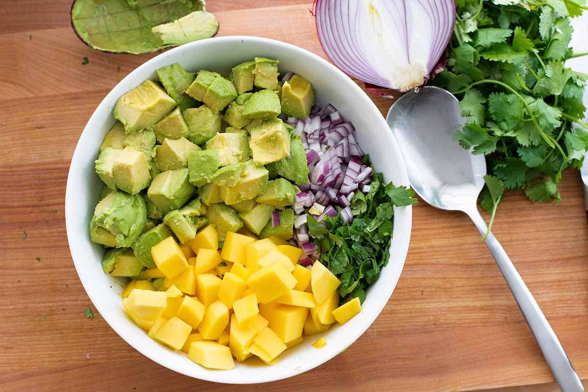 Mango Guacamole - - bowl of mangos and avocados