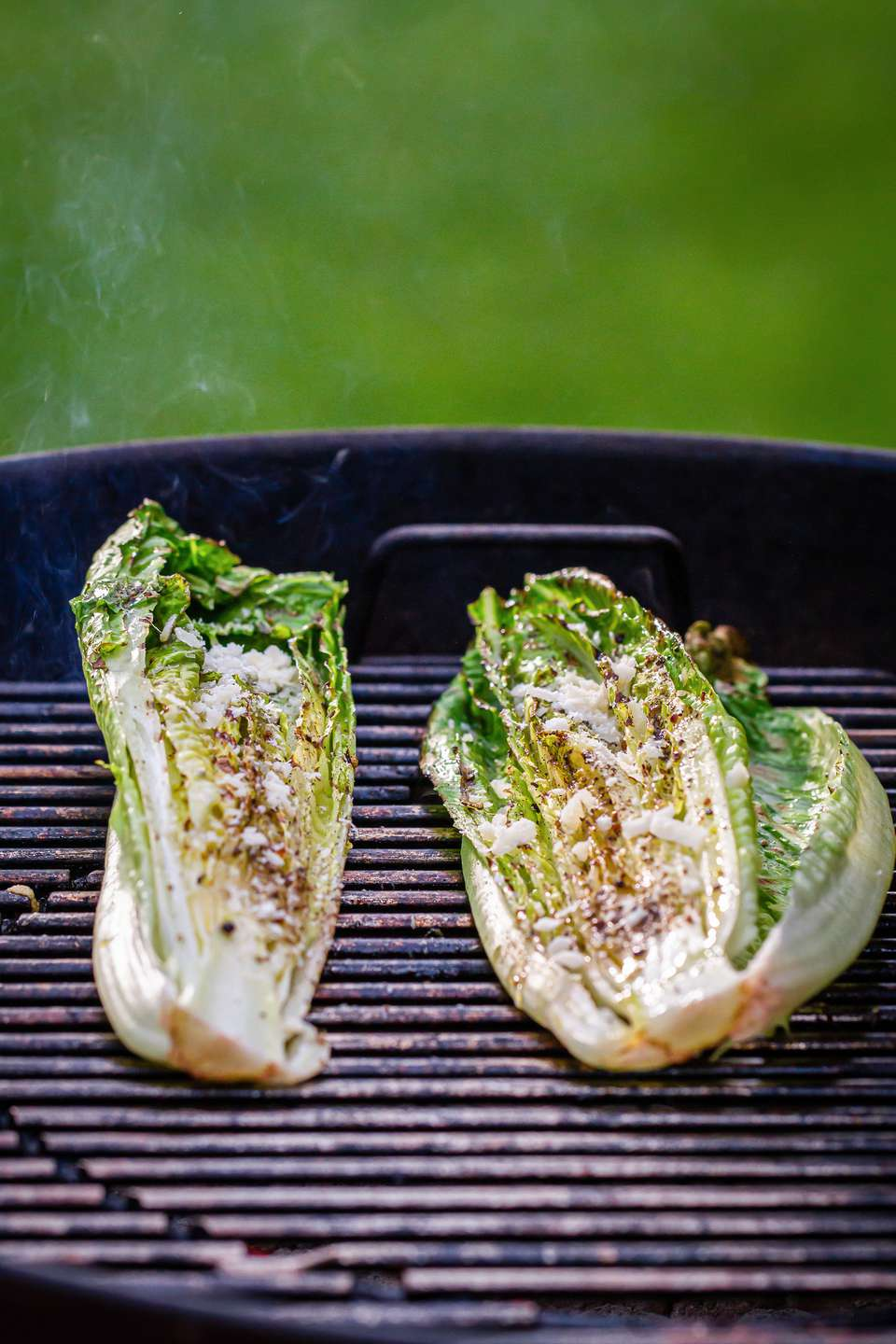 Grilled romaine lettuce on a Weber charcoal grill