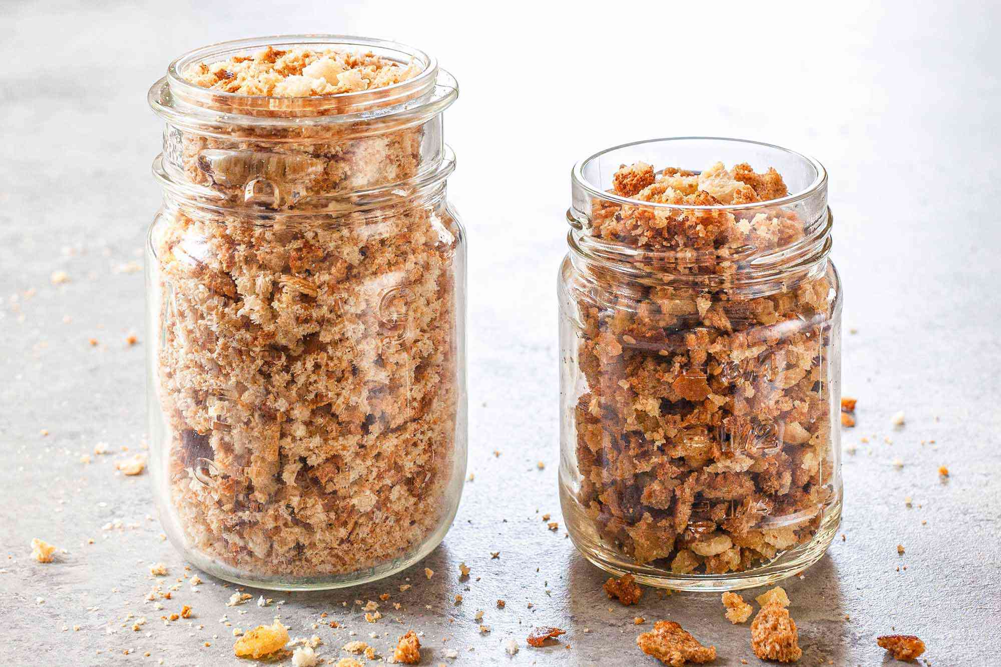 How to Toast Breadcrumbs in the Oven - two jars filled with toasted breadcrumbs