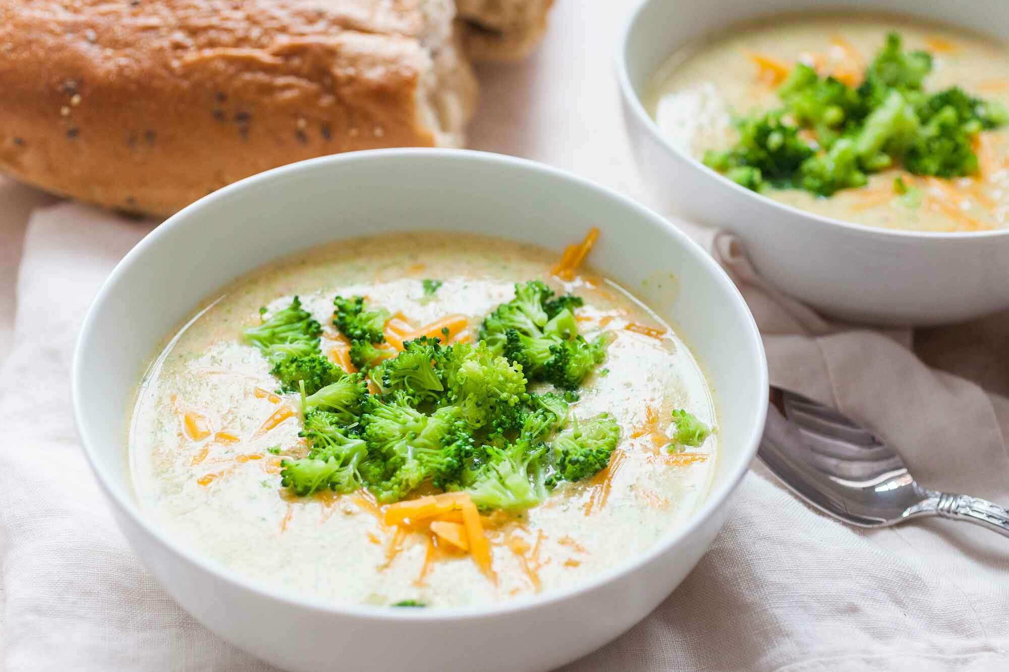 Broccoli Cheddar Soup Recipe served in bowls with bread
