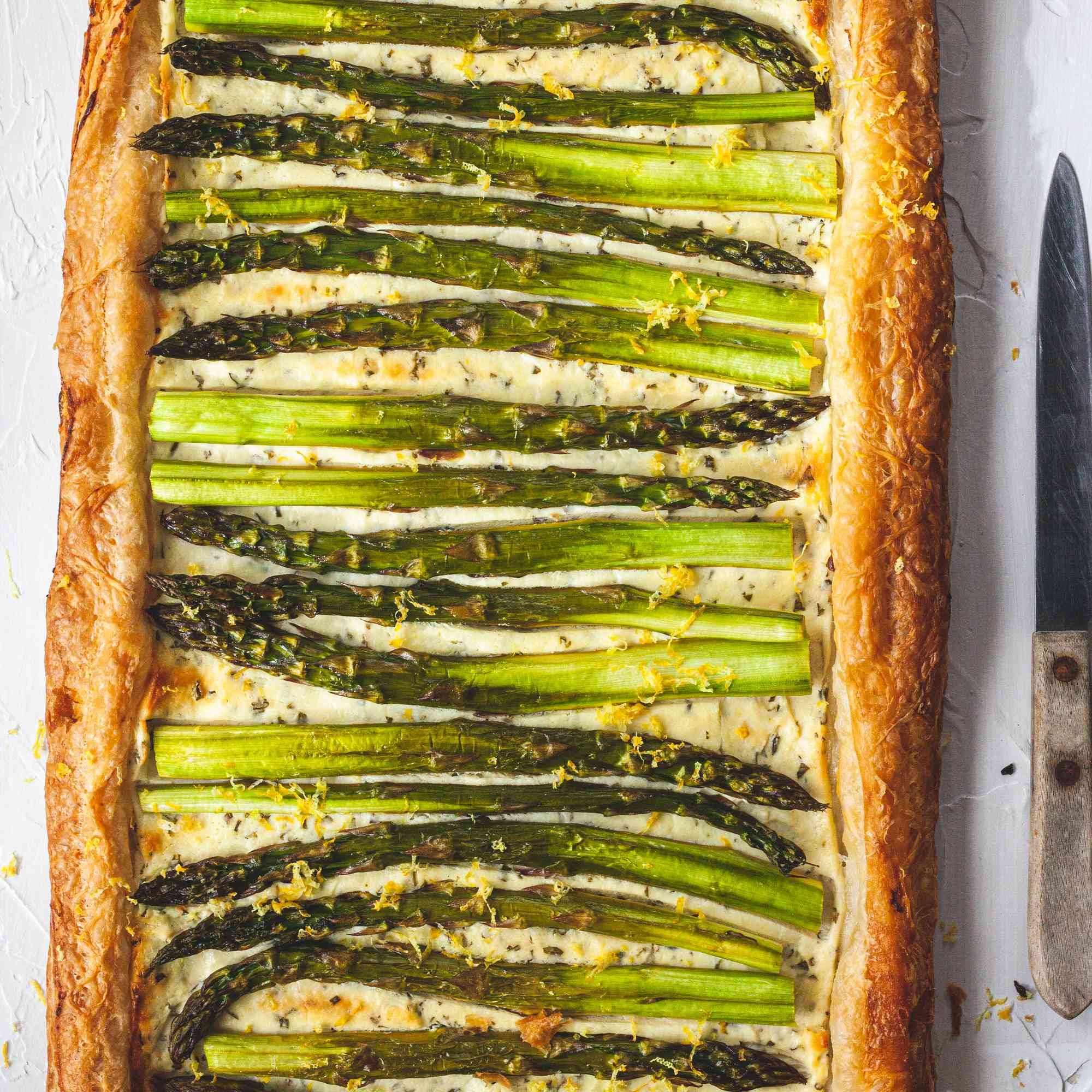 Easy Asparagus and Goat Cheese Tart on a platter.