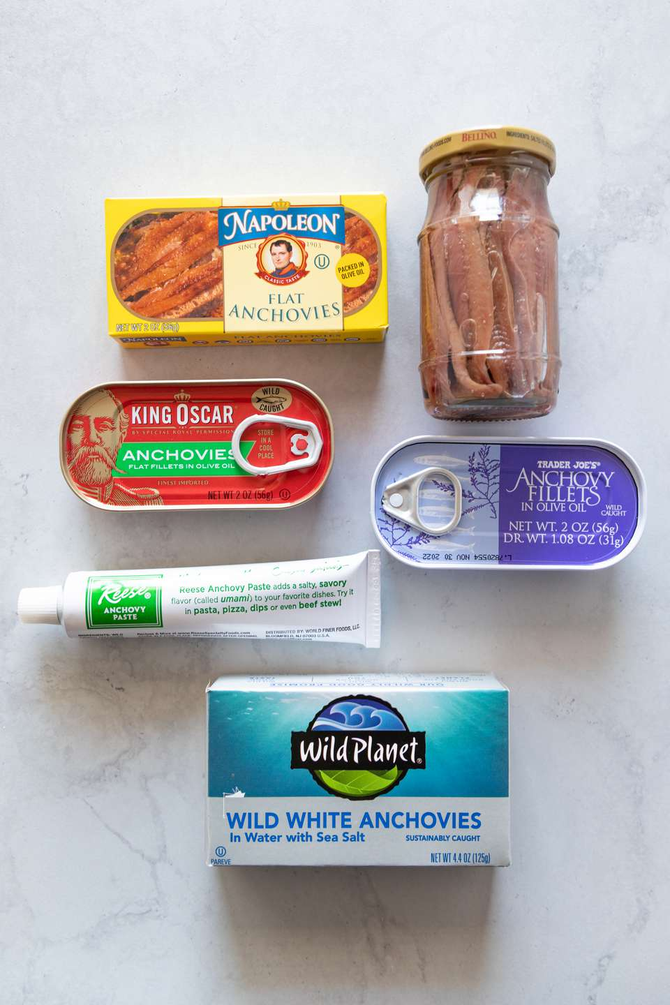 Cans, jars, and tubes of anchovies