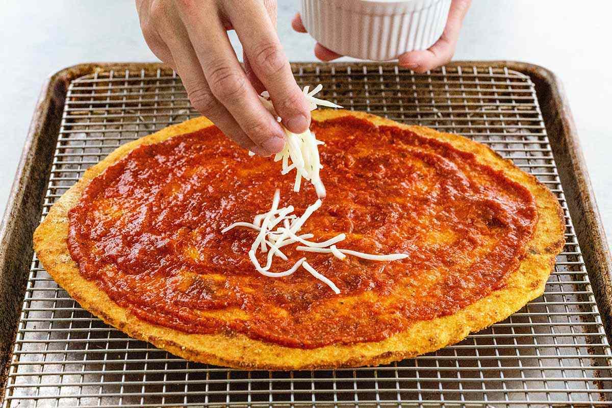 Cauliflower Pizza Recipe add the cheese
