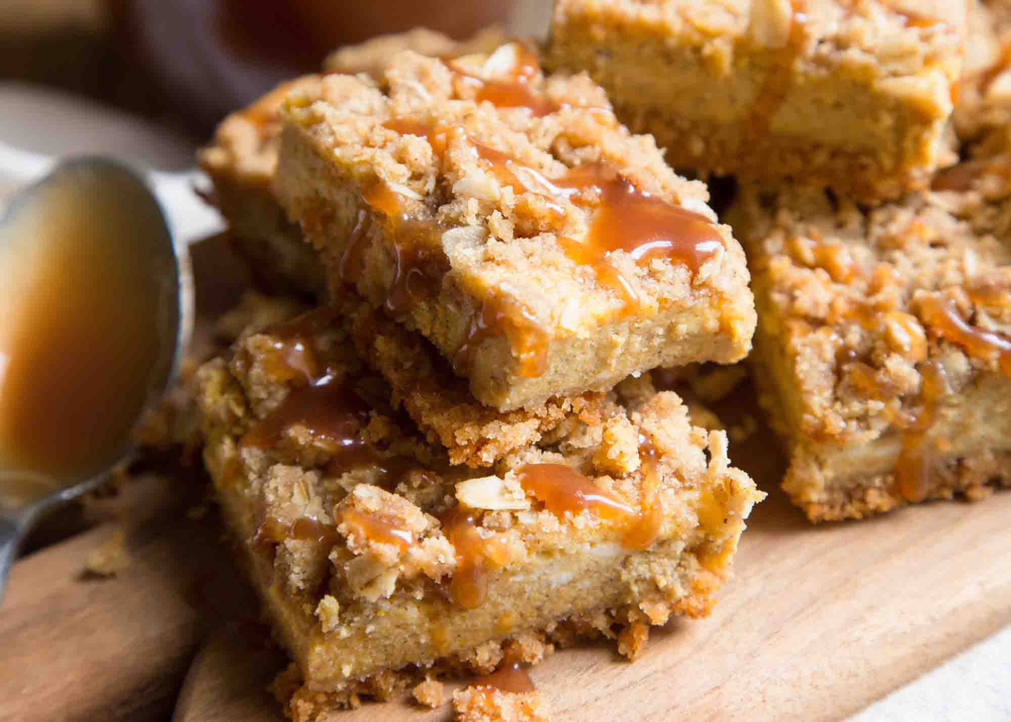 pumpkin cheesecake bar with struesel topping and caramel sauce