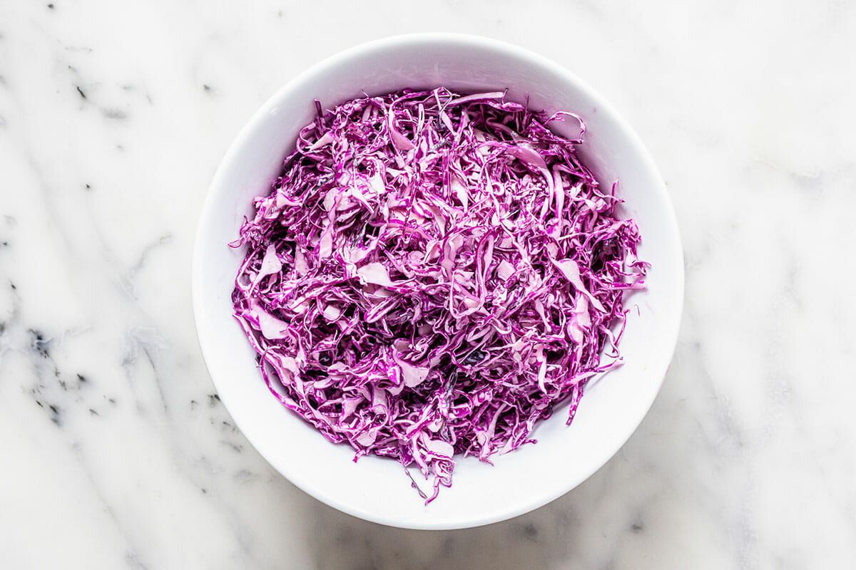 Shredded cabbage in a bowl for a fish taco recipe.