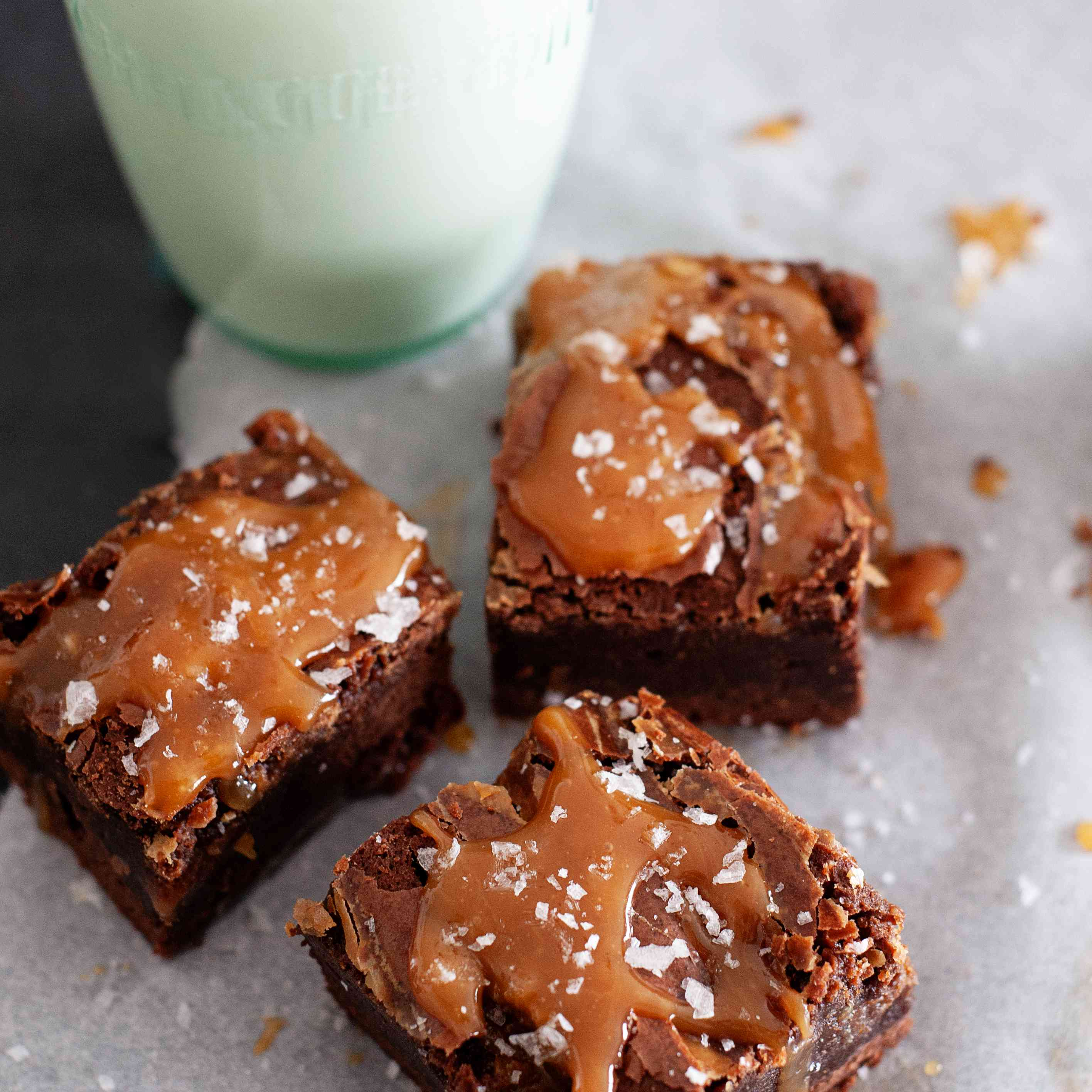 Fudgy Caramel Swirl Brownies with a glass of milk