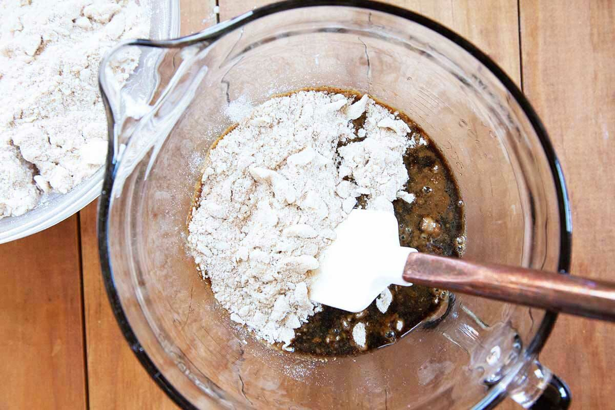 Shoo fly pie filling being made in a glass measuring cup.