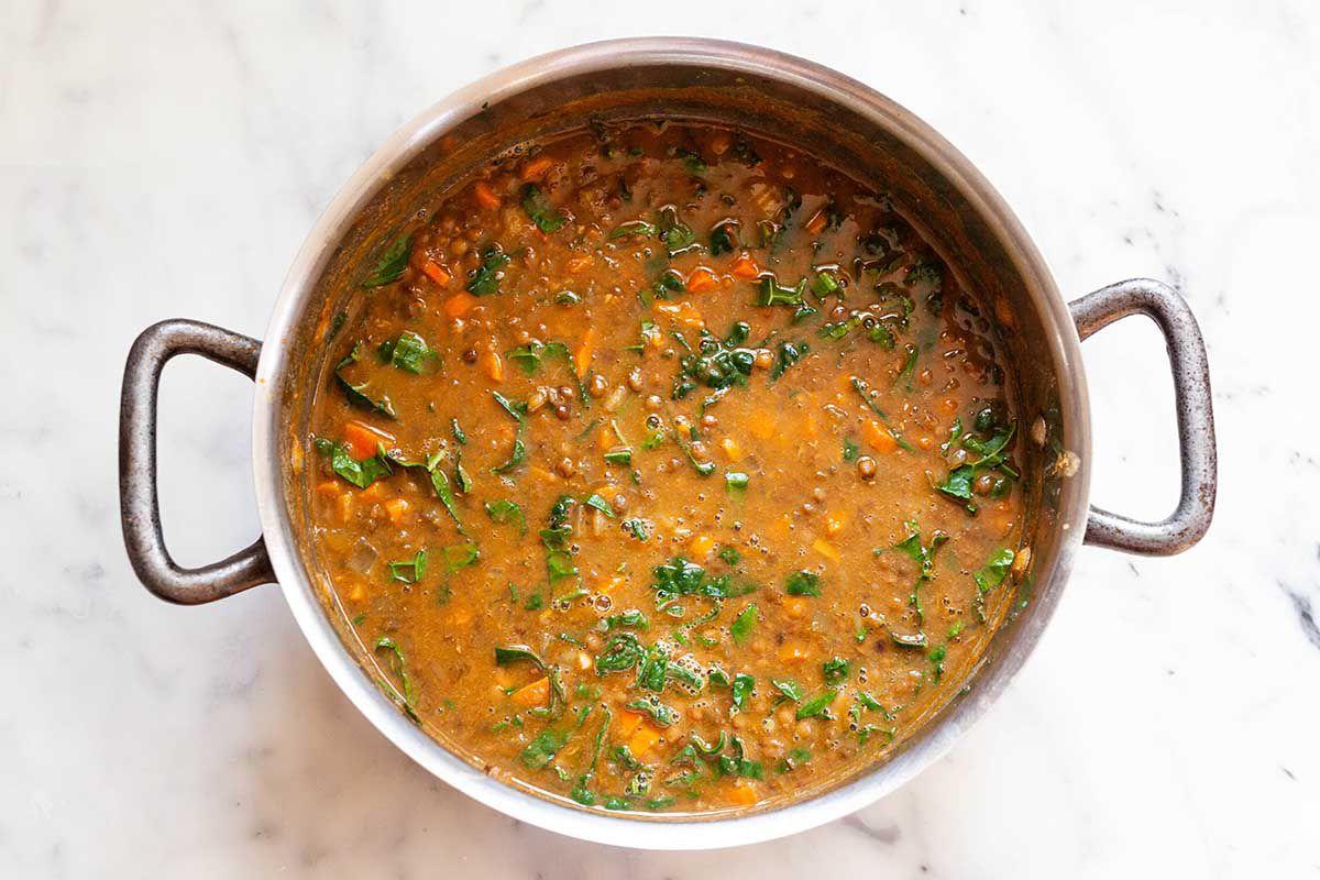 Pot of lentil soup with kale.