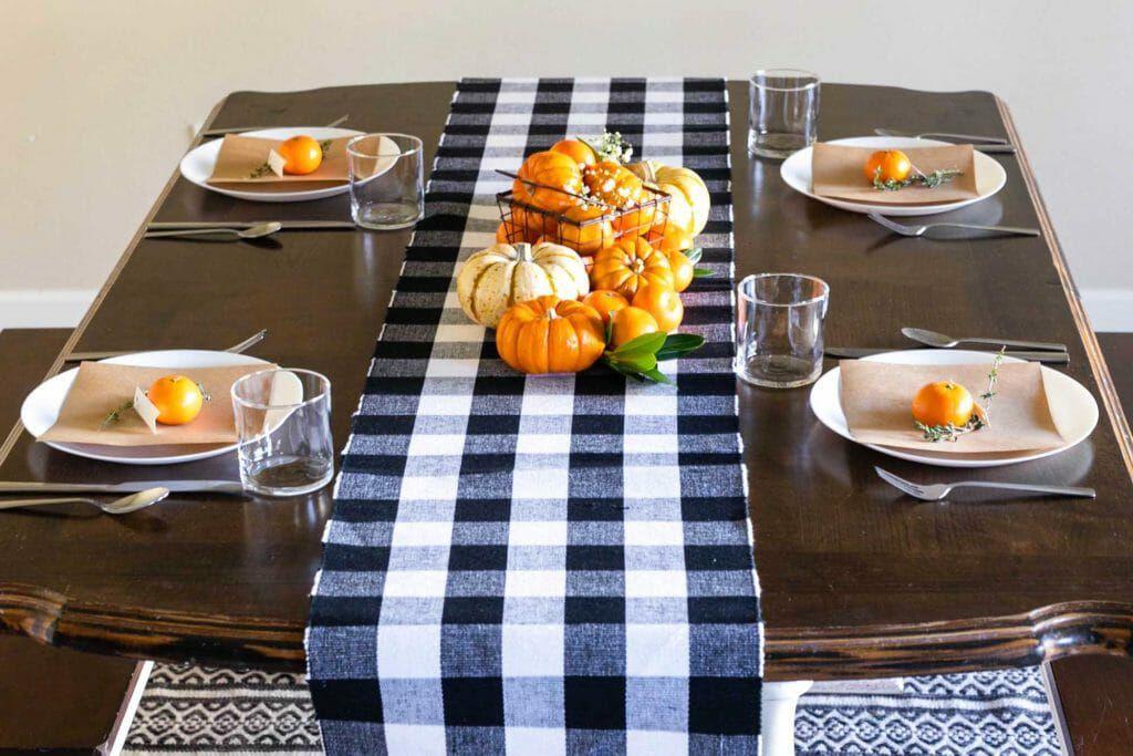 orange black and white thanksgiving table setup