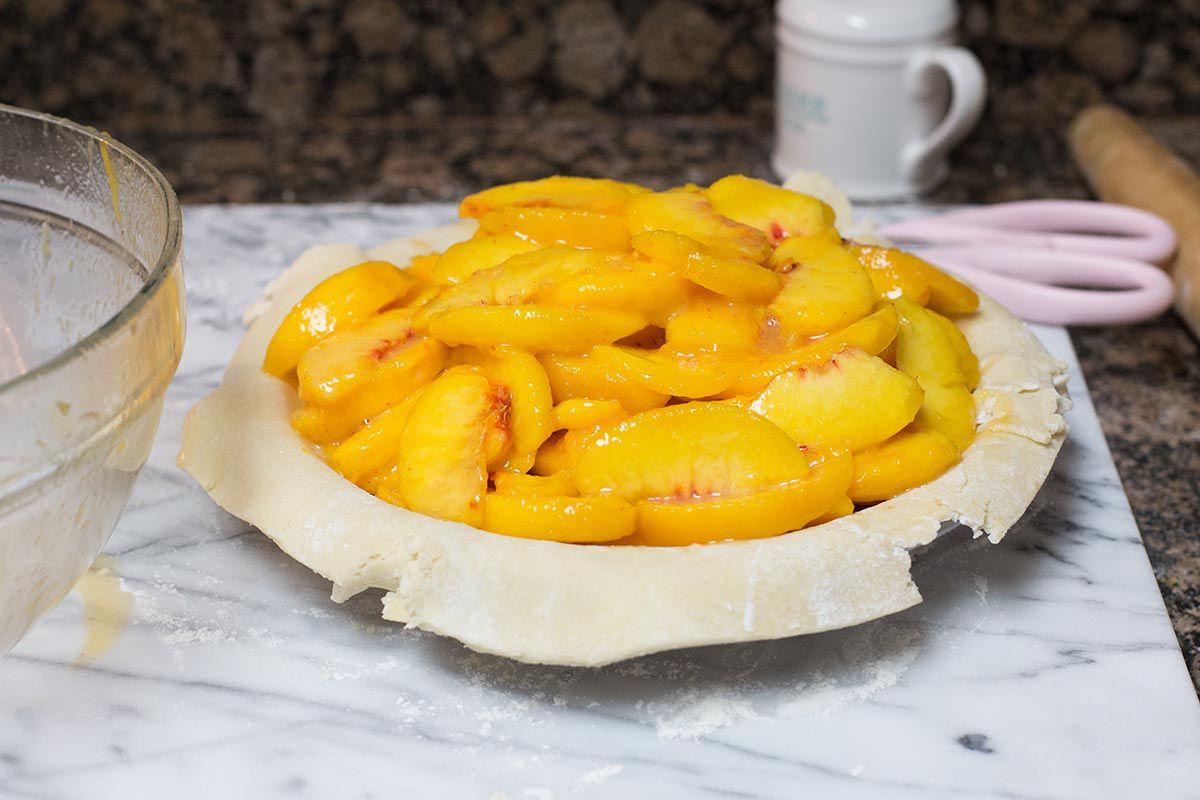 Peach Pie filling inside the pie crust