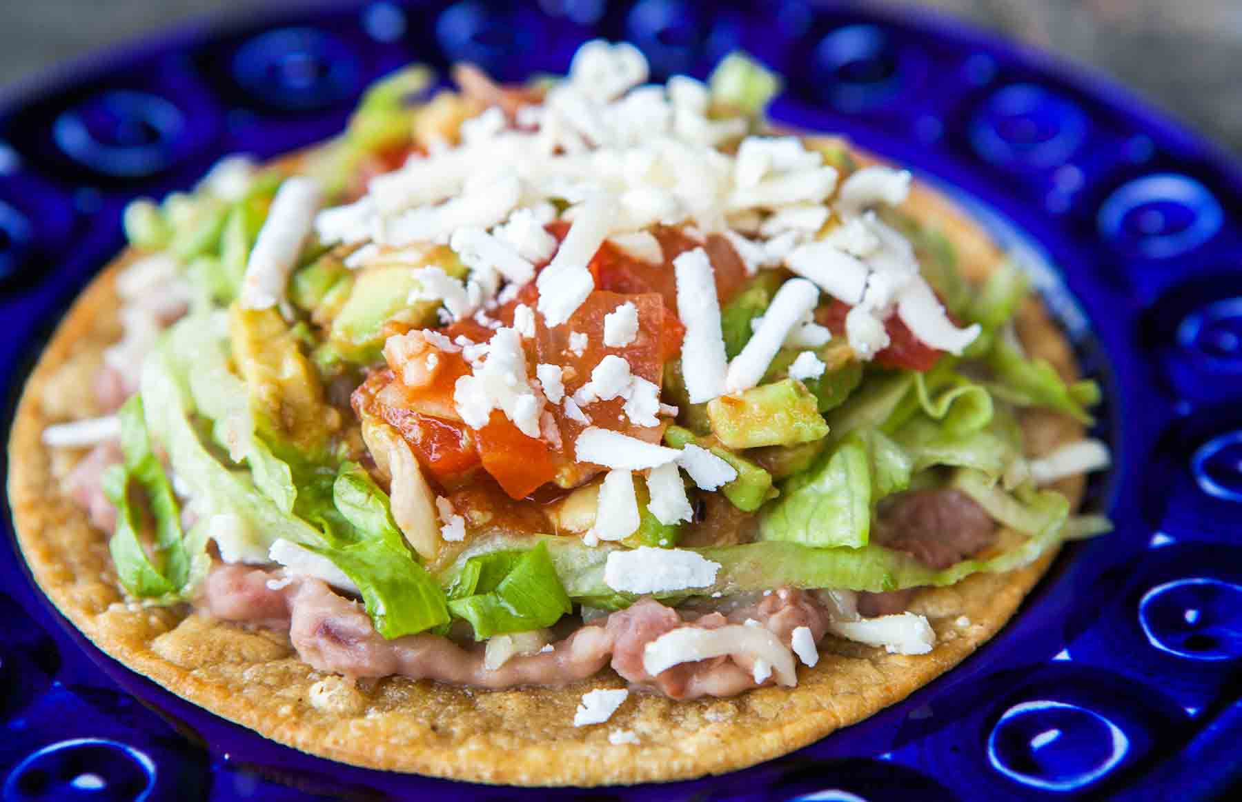 Mexican Tostada on blue plate
