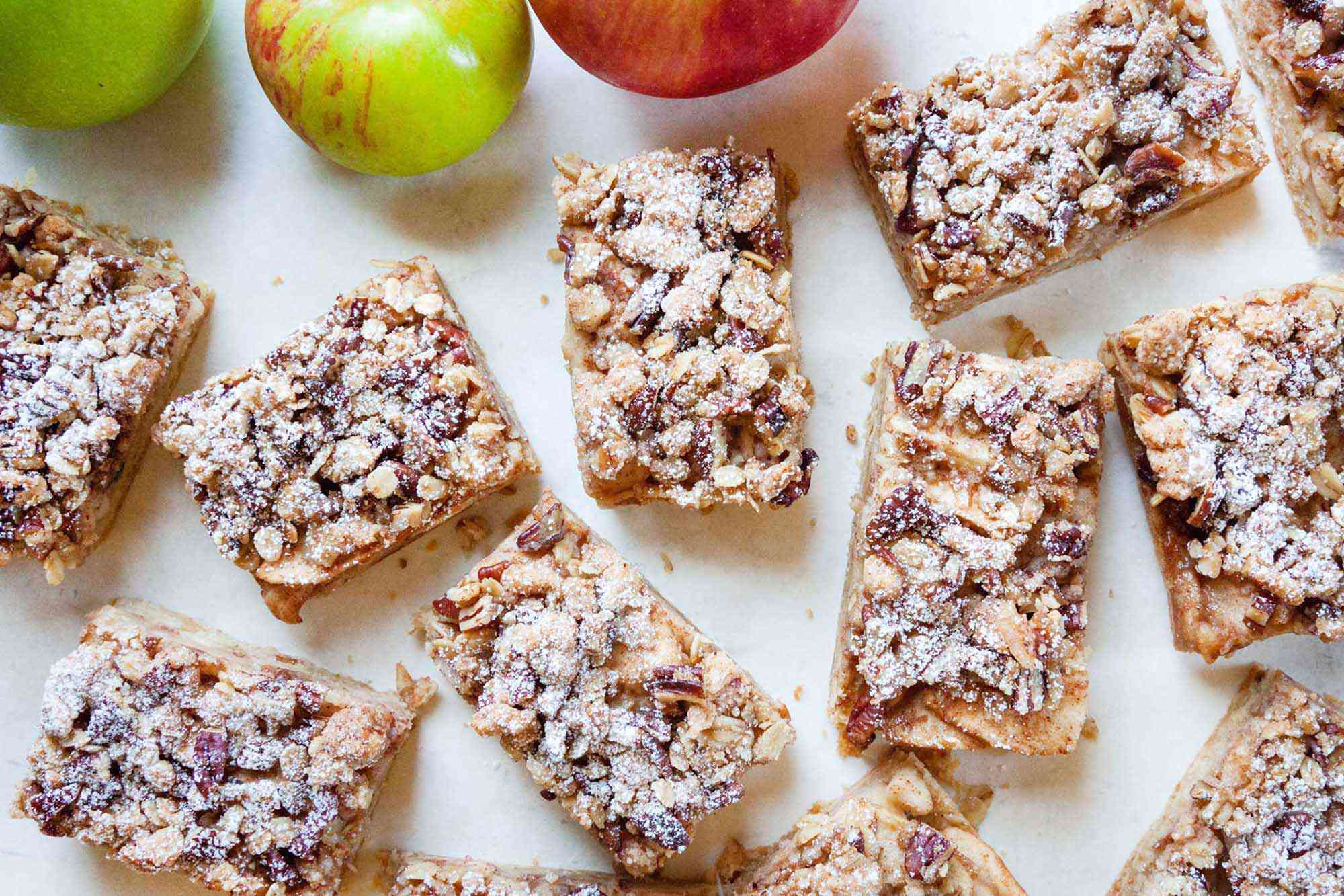 Overhead view of the best apple pie bars cut into rectangles and sprinkled with powdered sugar.