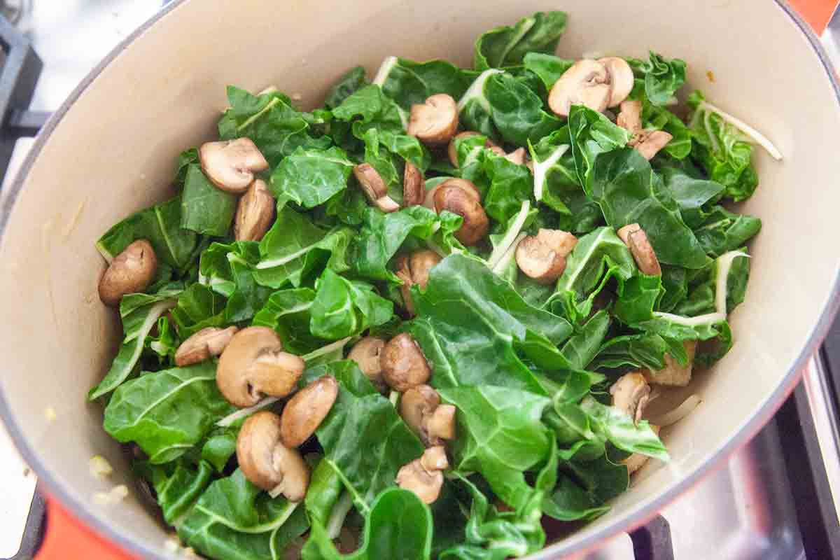 layer chard and mushrooms over bread and onions in dutch oven for panade