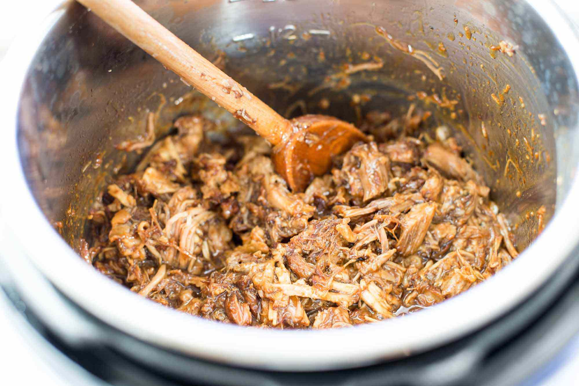 Chinese Pulled Pork in Electric Pressure Cooker Mix the Pork and Sauce