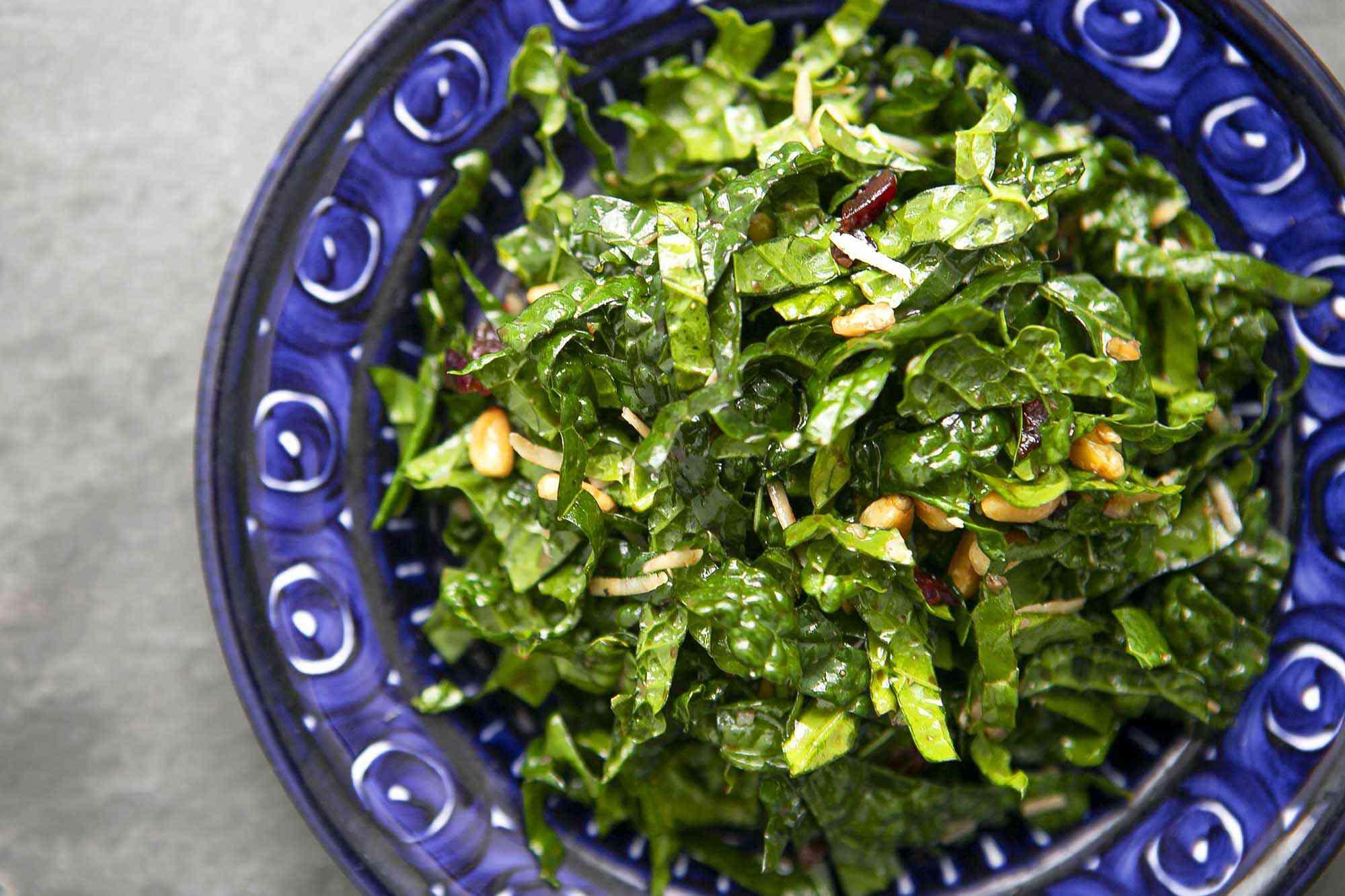 easy kale salad served in a blue bowl