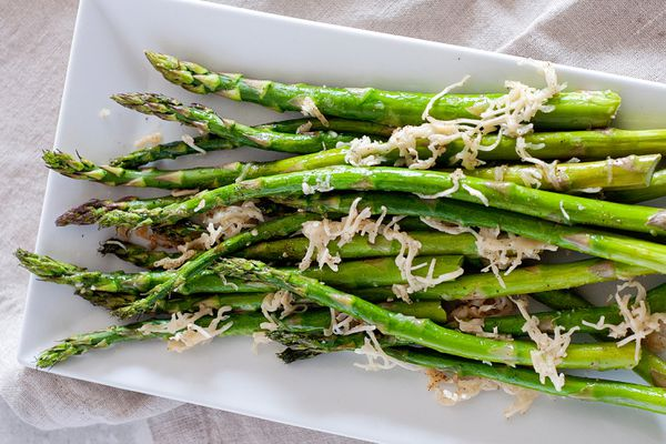 Oven baked asparagus on a platter.