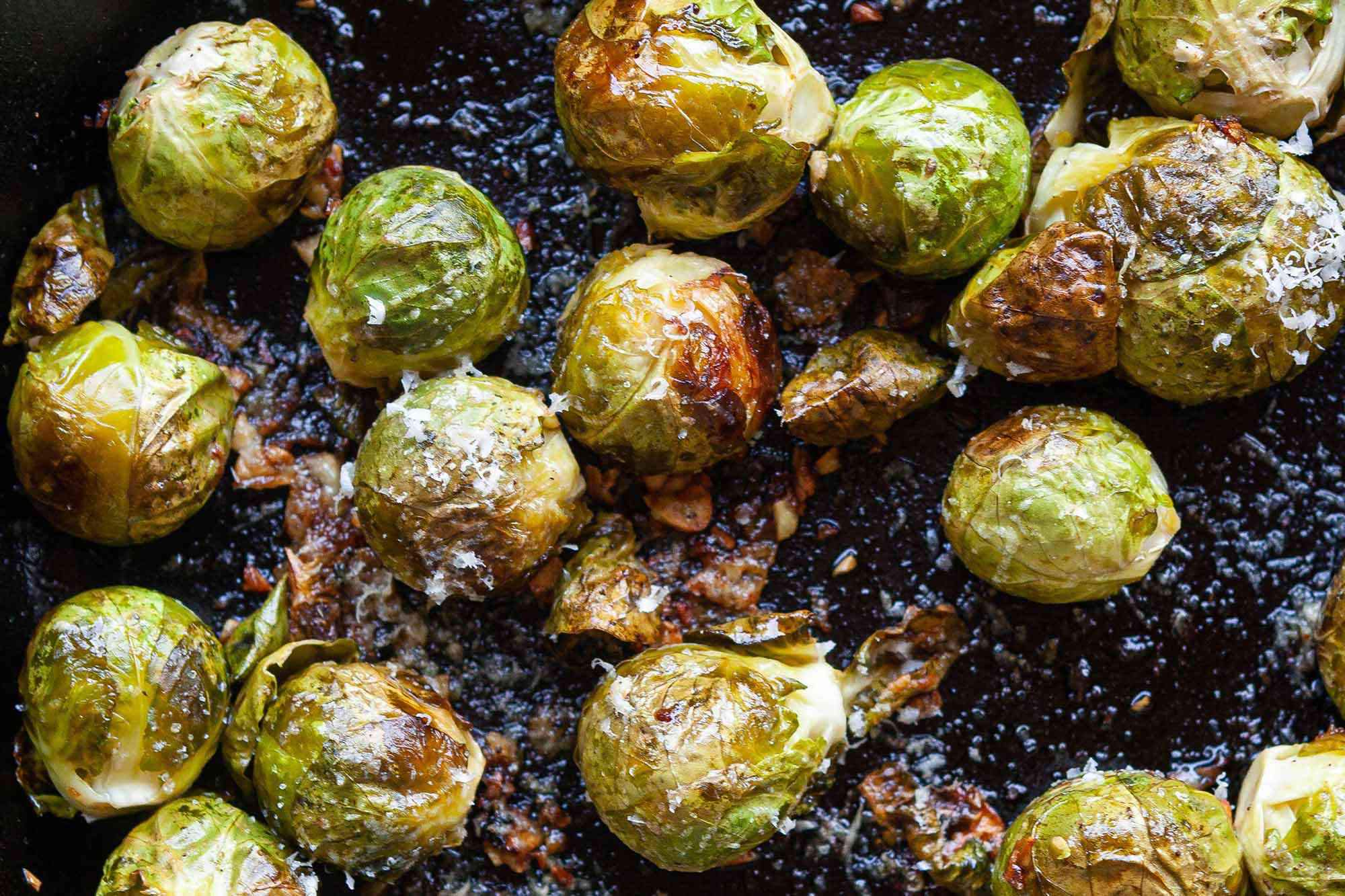 Close up shot of roasted brussel sprouts in a skillet