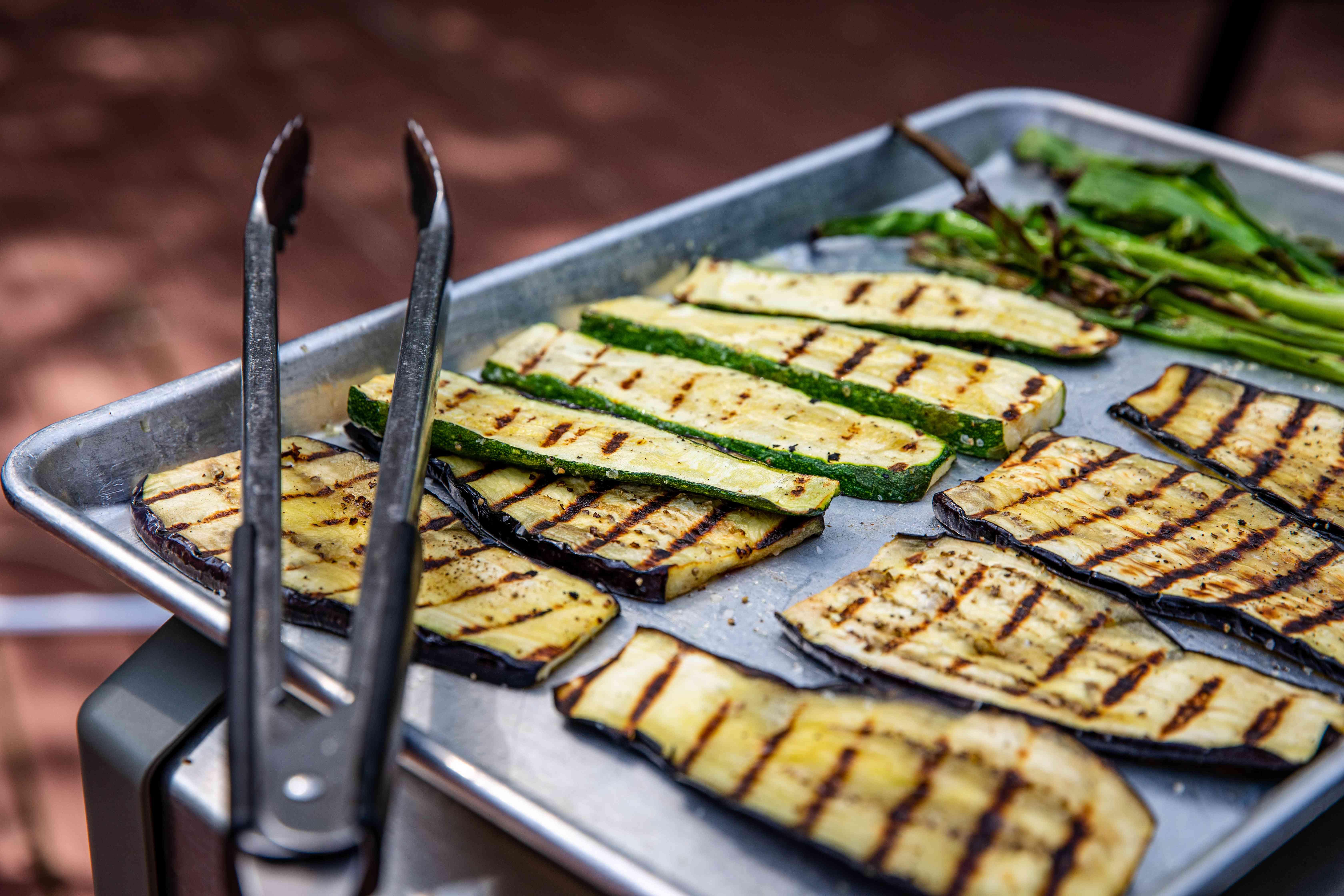 Grilled vegetables on a baking sheet to make easy grilled vegetable nachos.