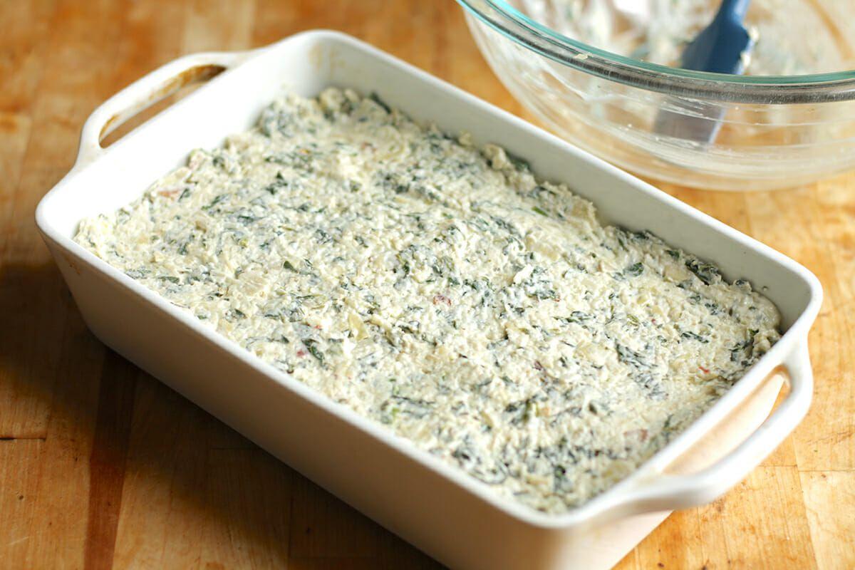 Spinach Artichoke Dip in casserole dish ready to bake