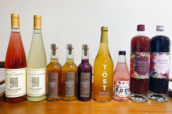 Non-alcoholic wines lined up on a table.