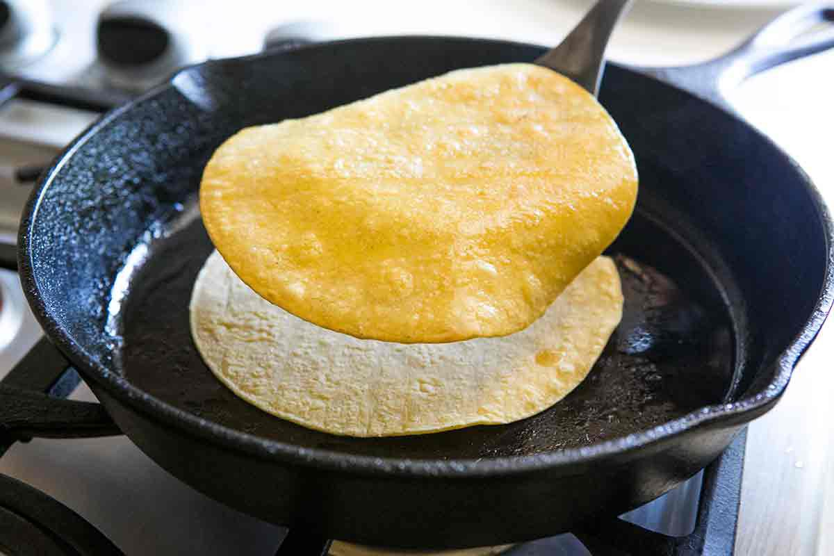 stack fried tortilla on top of newly placed tortilla to soften tortillas for enchiladas