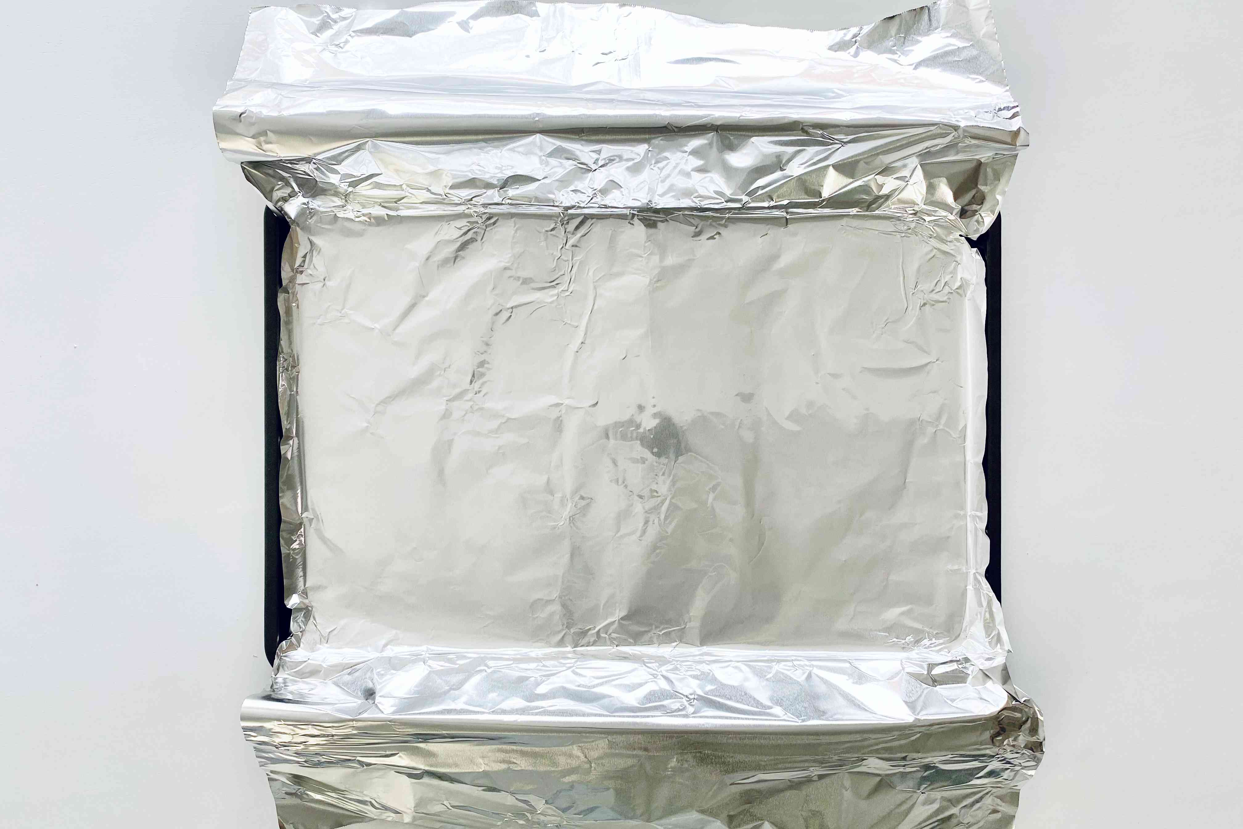 Foil lined baking sheet to make Garlic Butter Baked Salmon.