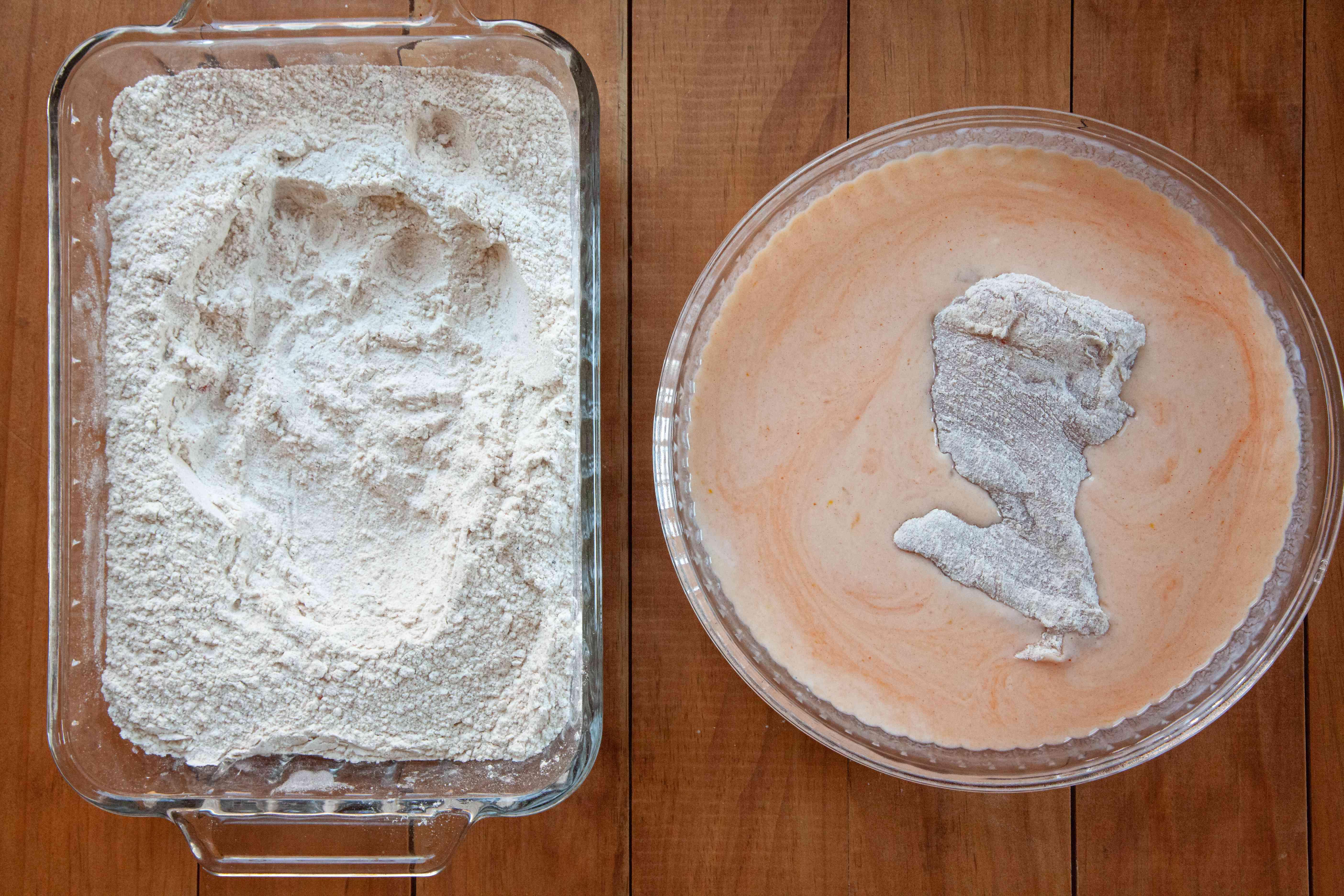 Floured chicken thigh set in the wet mixture for a Nashville-style hot fried chicken.