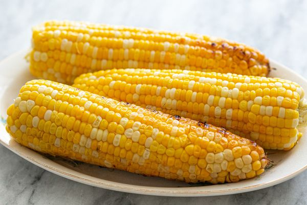 Grilled corn on the cob served on an oval platter