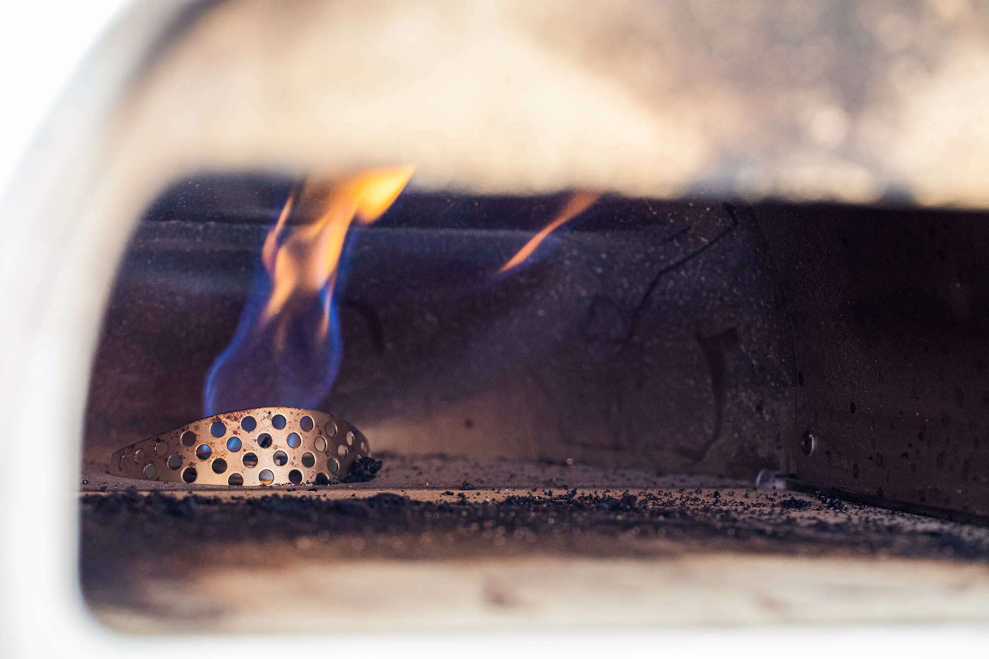 What is the Roccbox? This photo shows the inside of the pizza oven with the flame visible.