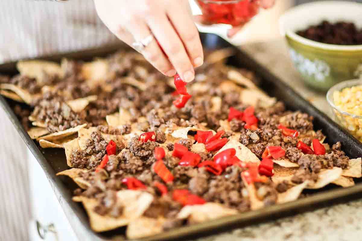 Sheet Pan Nachos with Black Beans add the peppers