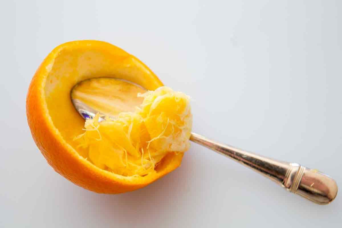 scrape orange with spoon