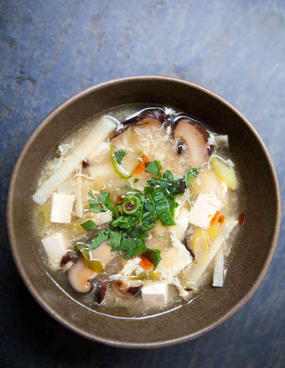 Easy Chinese Copycat Hot and Sour Soup with tofu and mushrooms served in a bowl