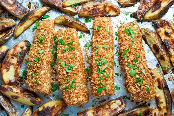 Baked Fish and Chips Garnished with Fresh Parsley