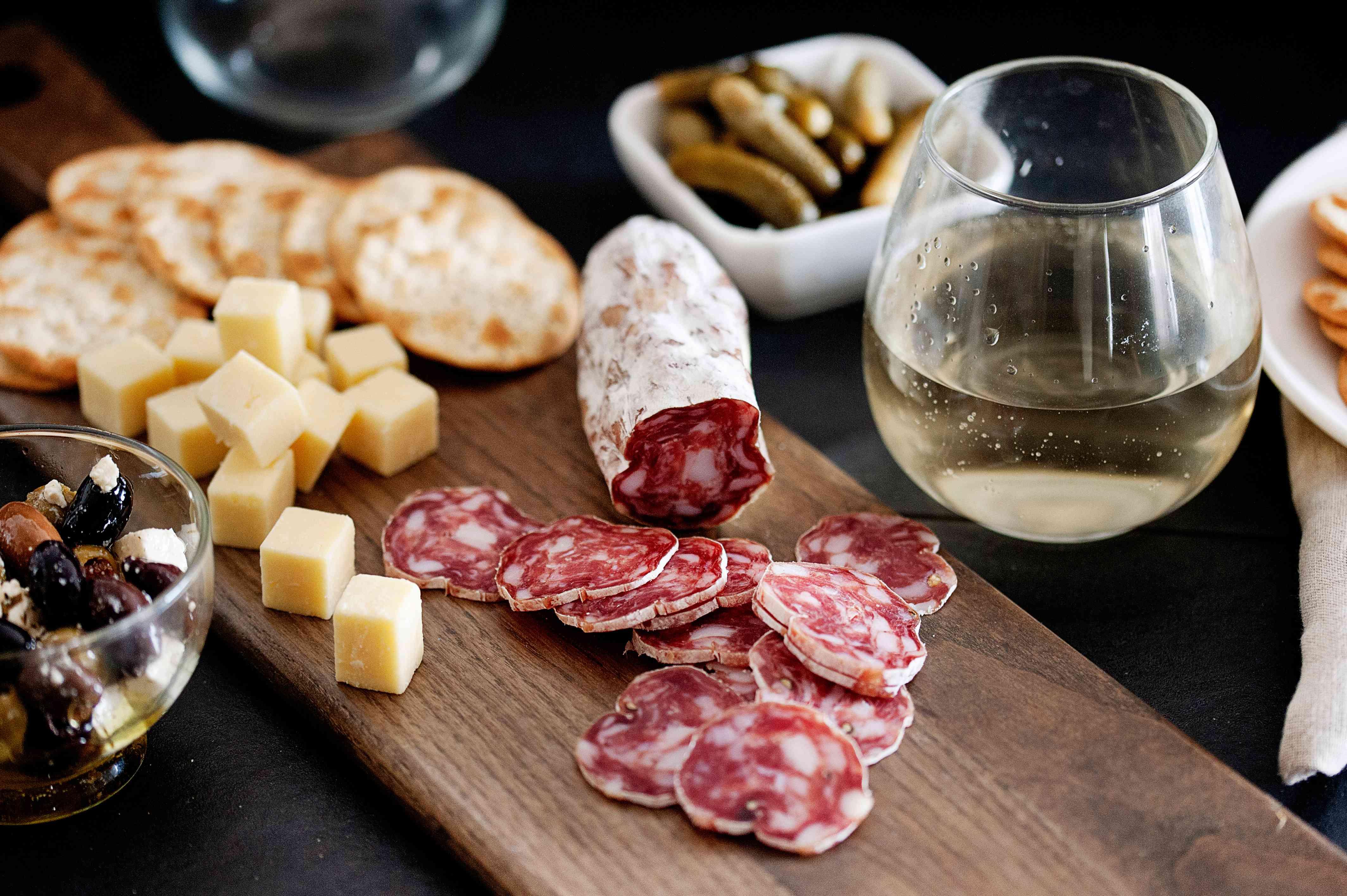 charcuterie spread with wine and soppressata