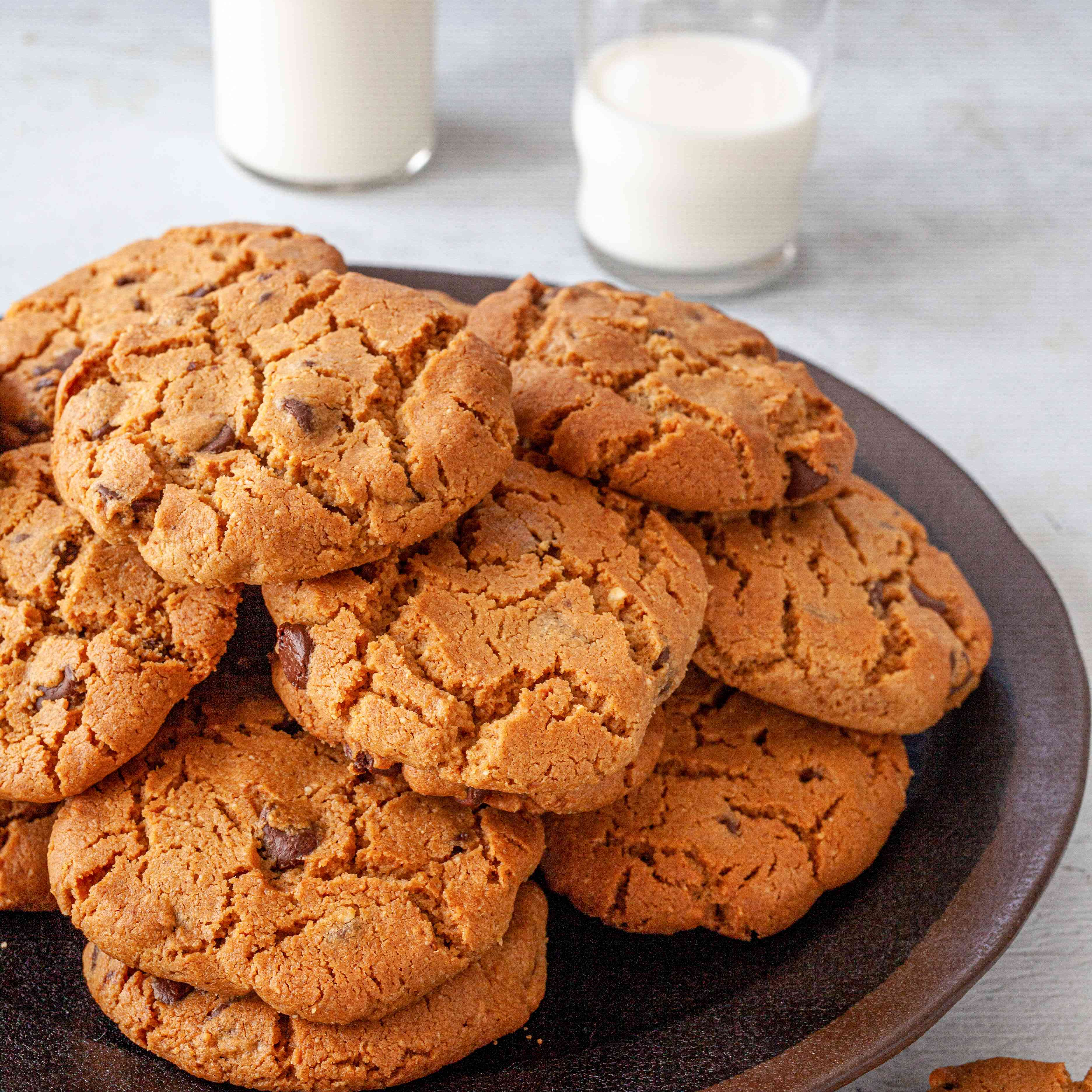 Gluten-Free Peanut Butter Chocolate Chip Cookies stacked on a plate.