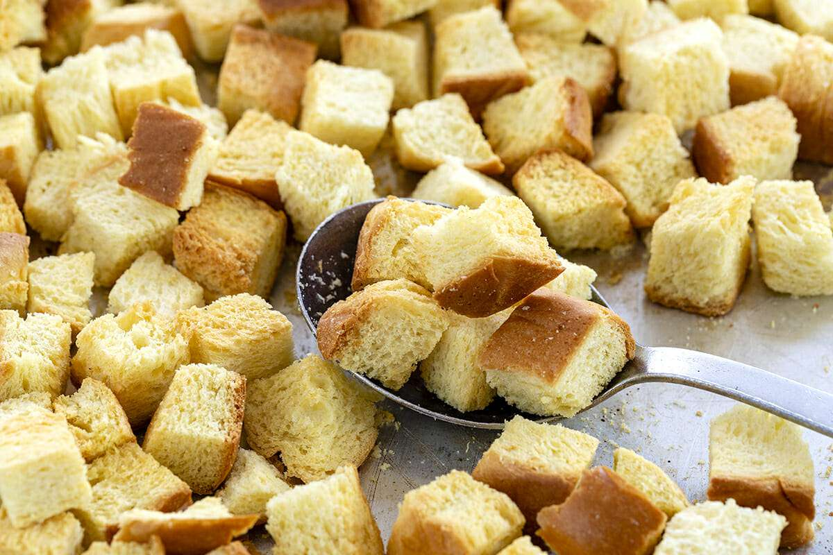 French Toast Casserole Overnight Recipe - toasted bread cubes on baking sheet