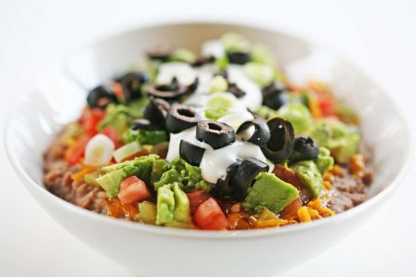 Completed 7 Layer Dip Recipe in Large White Bowl
