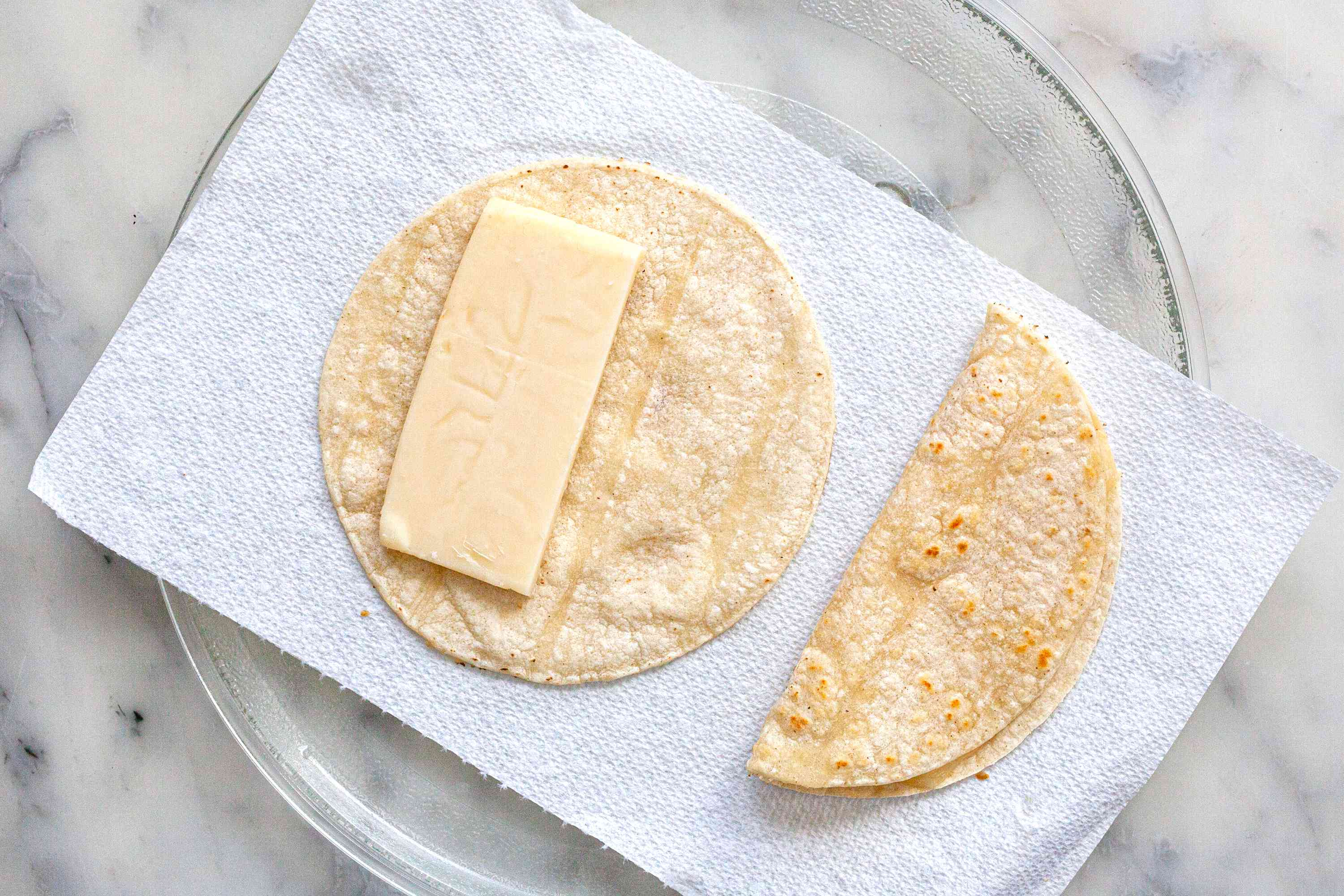 Melting cheese on a microwave platter to make a vegetarian tacos recipe.