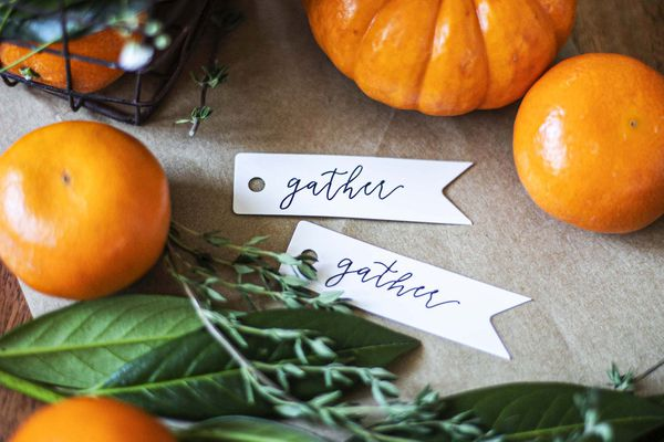 clementines and pumpkins with gather place cards