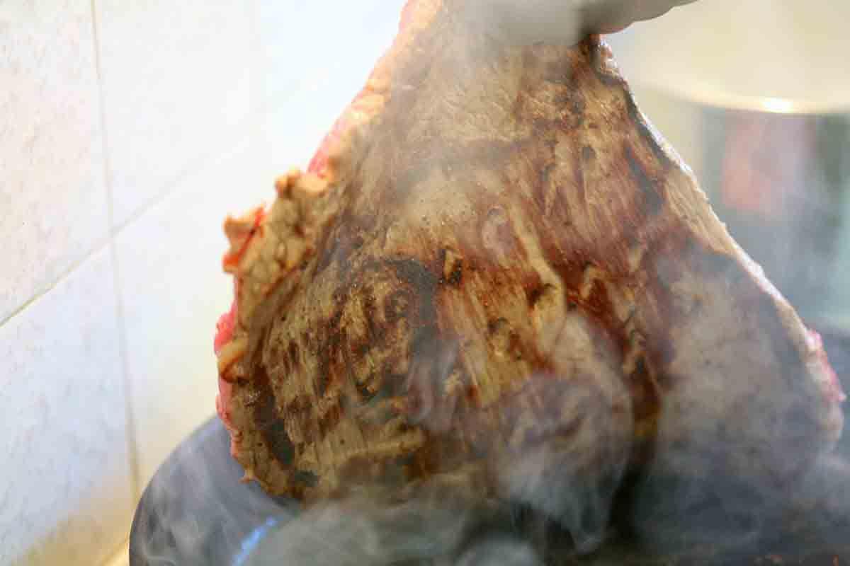 turn flank steak over in pan