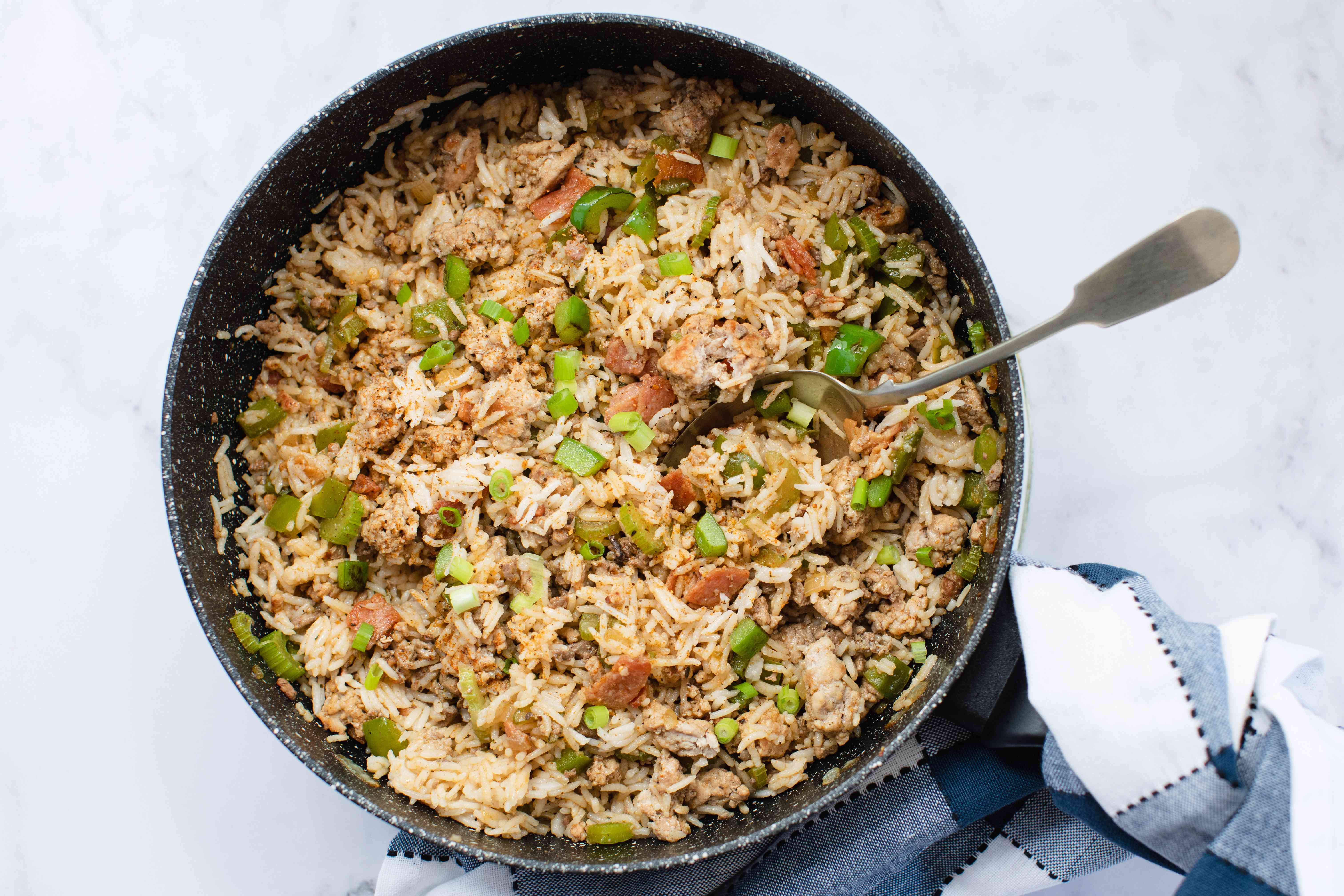 Overhead view of dirty rice in a skillet.