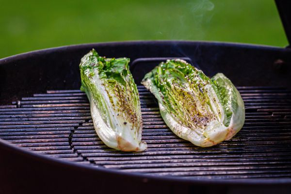 Lettuce grilling on a Weber charcoal grill