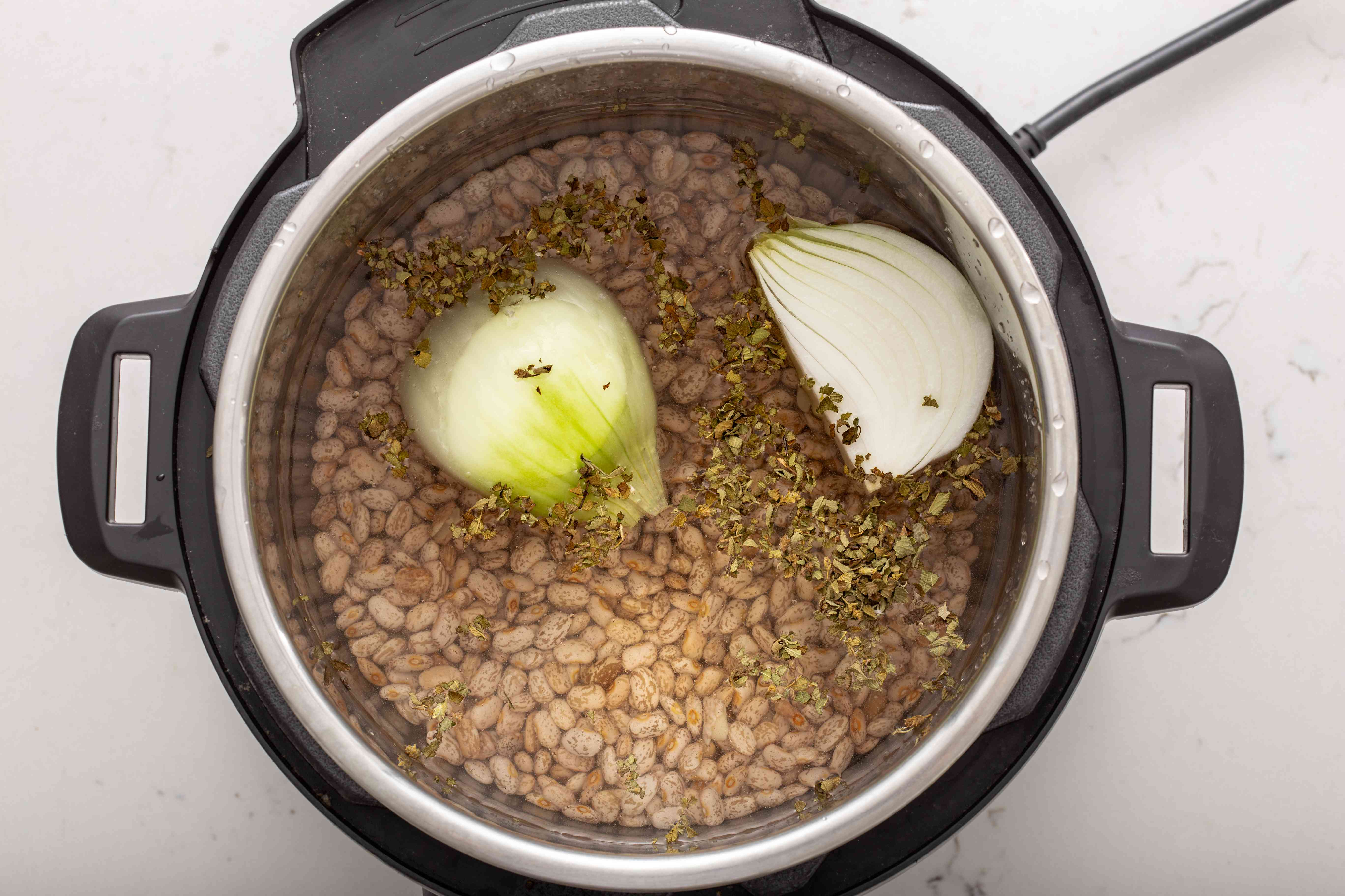 Making refried beans in a pressure cooker.