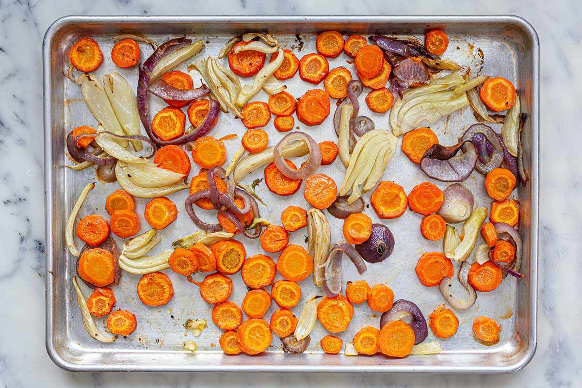 A sheet pan with roasted vegetables for a Rustic Winter Vegetable Galette.