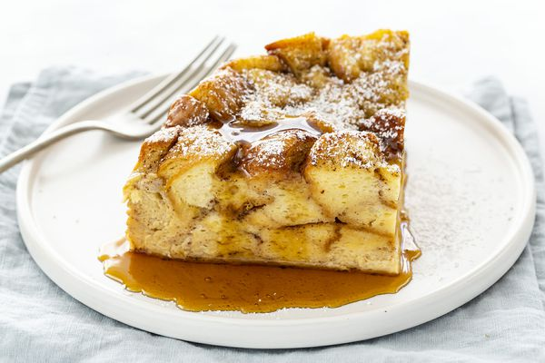 Slow Cooker French Toast Casserole Recipe - slice french toast casserole on plate with syrup and fork