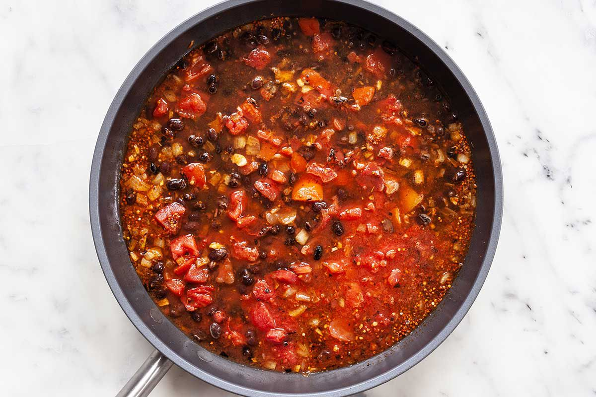 Black beans, tomatoes, butternut squash and spices mixed together in a saute pan for easy vegetarian skillet dinner.