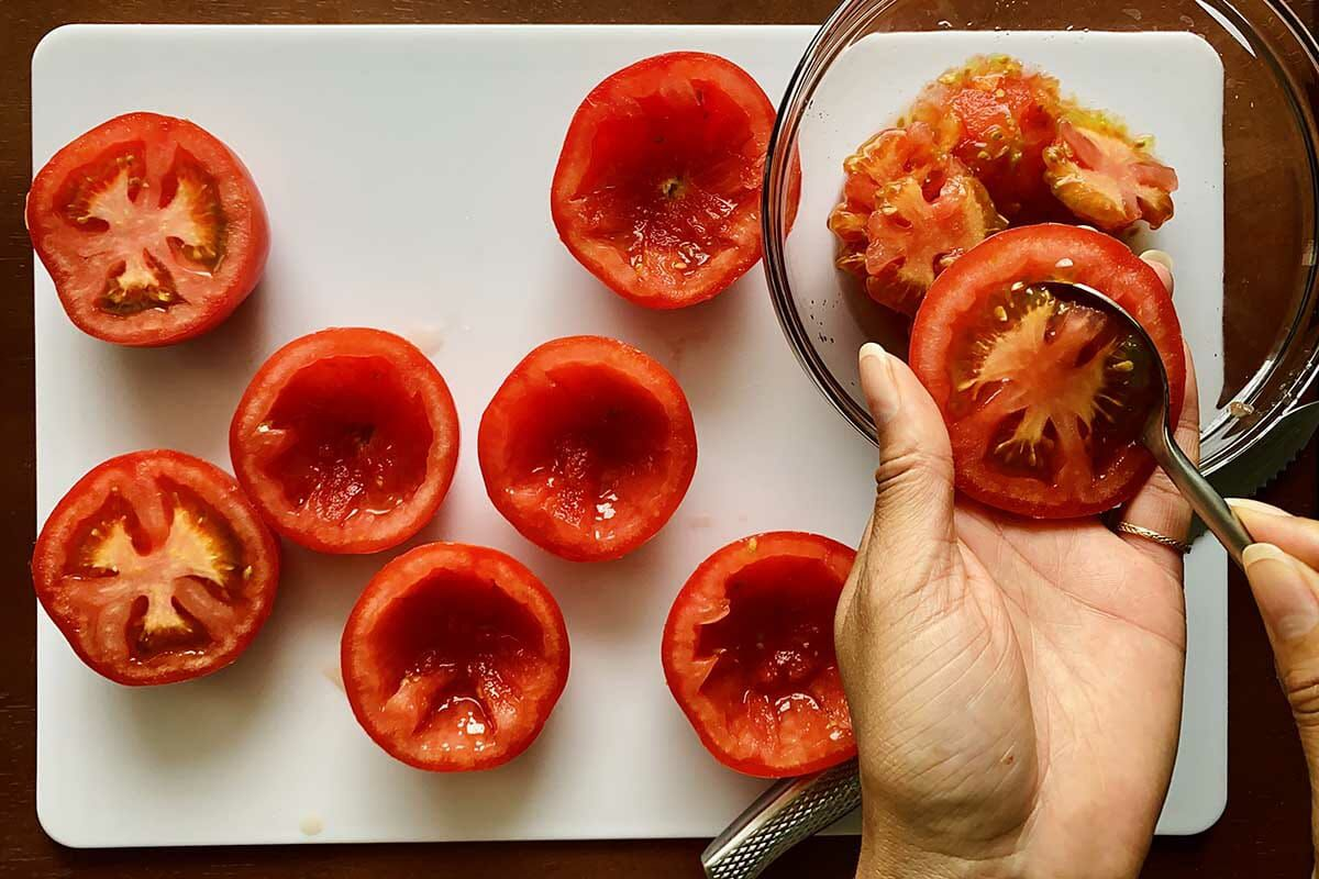 How to make stuffed tomatoes by removing the core and seeds of a halved tomato.