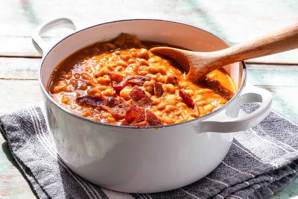 Baked Beans with Molasses - baked beans in a pot with a wooden spoon