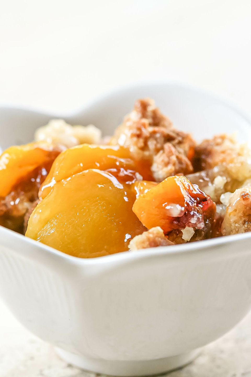 A bowl of easy peach cobbler